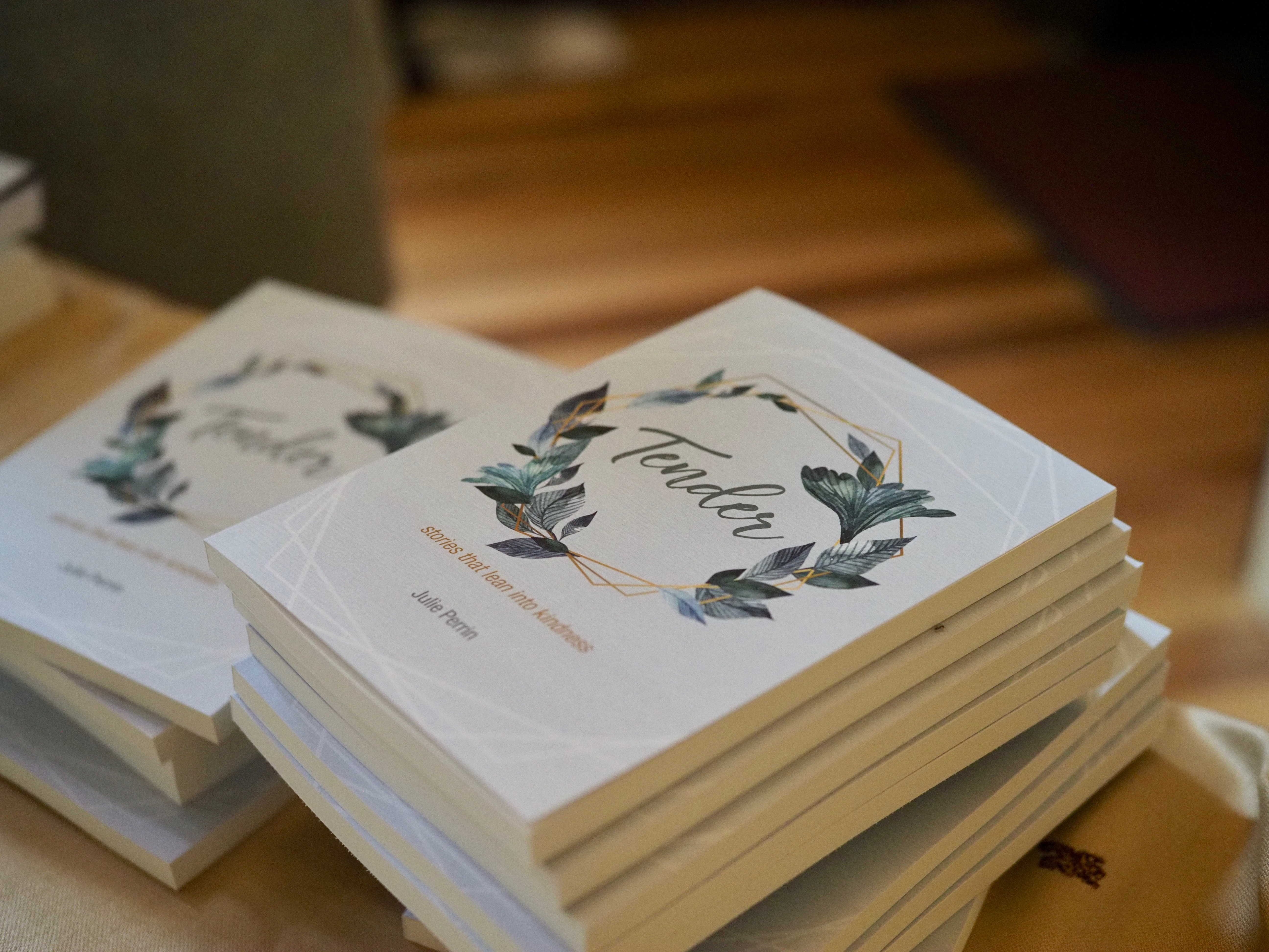 copies of the book 'Tender, stories that lean into kindness'