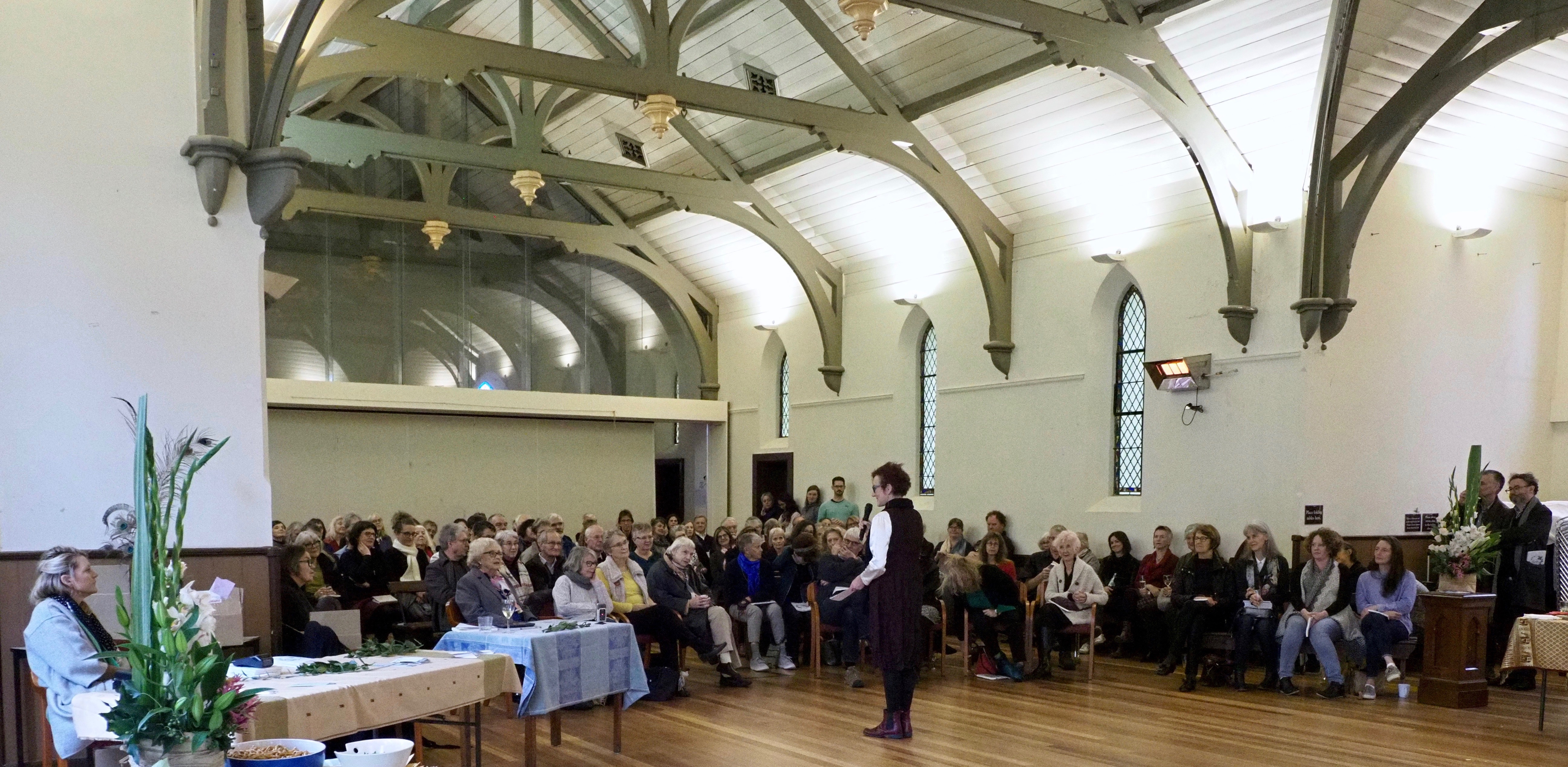 crowd in church hall at book launch